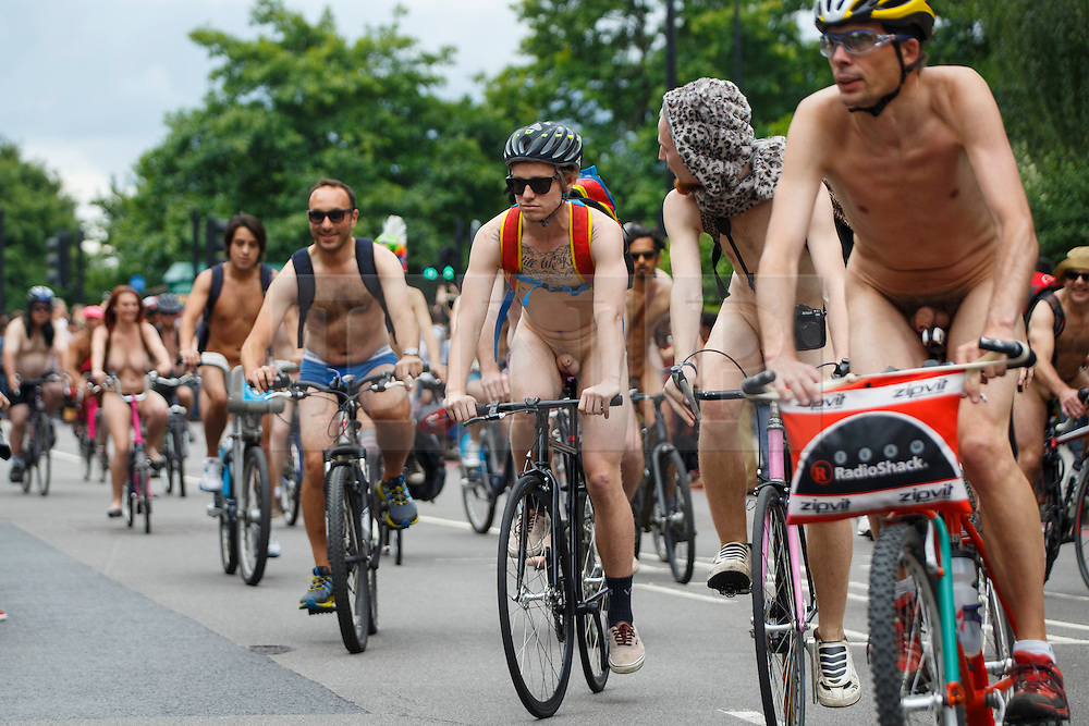 © Licensed to London News Pictures. 14/06/2014. LONDON, UK. Nude protesters cycle through the streets of London on Saturday, 14 June 2014 as part of the World Naked Bike Ride event, which aims to raise awareness of cyclists on the roads and in the traffic. . Photo credit : Tolga Akmen/LNP
