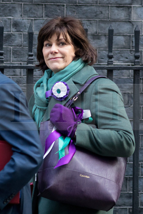 © Licensed to London News Pictures. 06/02/2018. London, UK. Secretary of State for Business, Energy and Industrial Strategy Claire Perry arriving in Downing Street to attend a Cabinet meeting this morning. Perry is wearing symbolic green and purple colours, as today is the 100th anniversary of women's right to vote.Photo credit : Tom Nicholson/LNP