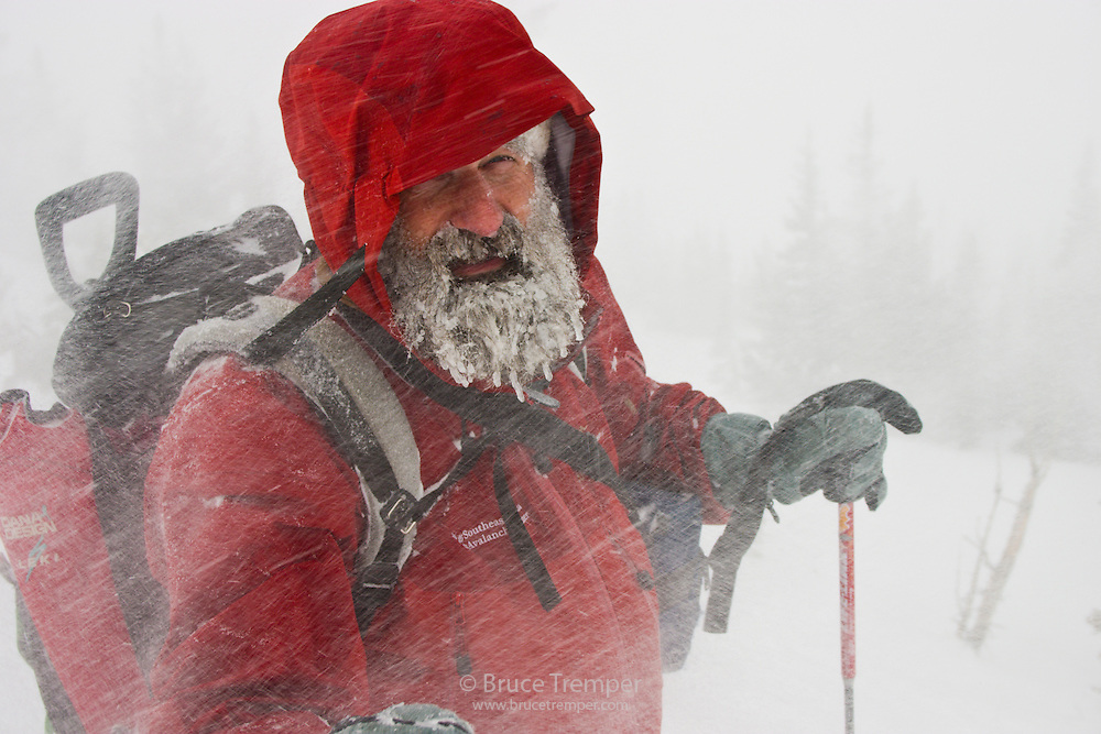 Alaska avalanche forecaster, Bill Glude, Alta, Utah doing avalanche work in a howling blizard.  The Avalung device on his chest allows him to breathe while under avalanche debris in case something goes wrong.