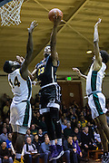 San Francisco State forward Chiefy Ugbaja (23) lays the ball up against the San Francisco Dons at Kezar Pavilion in San Francisco, Calif., on December 6, 2016. (Stan Olszewski/Special to S.F. Examiner)