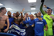 Brighton and Hove Albion players celebrate promotion to the Premier League after the EFL Sky Bet Championship match between Brighton and Hove Albion and Wigan Athletic at the American Express Community Stadium, Brighton and Hove, England on 17 April 2017.
