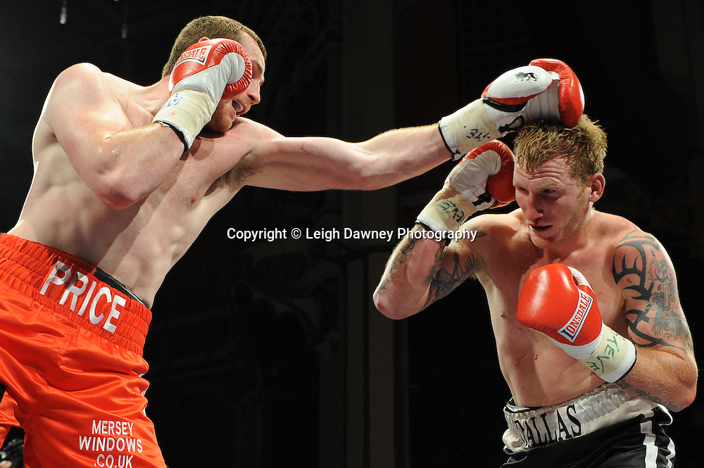 David Price (red shorts) defeats Tom Dallas in the British Heavyweight Title Eliminator contest at Olympia, Liverpool on the 11th June 2011. Frank Maloney Promotions.Photo credit: Leigh Dawney 2011