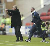 Photo: Aidan Ellis.<br /> Wigan Athletic v Manchester United. The Barclays Premiership. 14/10/2006.<br /> Wigan boss Paul Jewell goes mad at his side as Alex Ferguson asks for time.