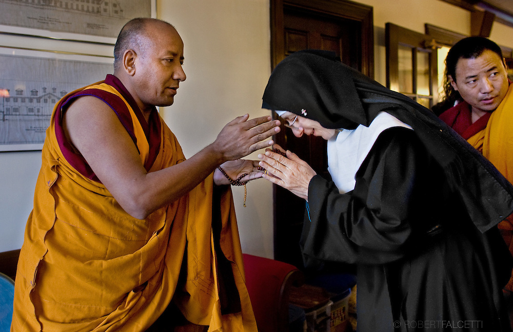 MIDDLEBURY, Connecticut- 13 February 2009- Geshe Lozang Samdup leader of a group of traveling Buddhist monks from the Drepung Gomang Monastery in southern India greets a nun from the Abbey of Regina Laudis. The monks were creating a Sand Mandala at the Westover School in Middlebury, Connecticut when they were visited by the nuns. (Photo by Robert Falcetti)