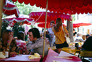 People sitting at tables of  outdoor cafe at Montnartre, Paris, France 1970