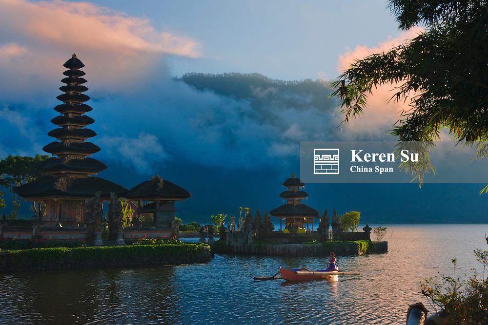Canoe with Pura Ulun Danu Bratan water temple, Bali island, Indonesia