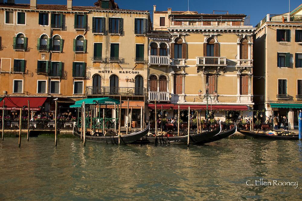 Gondolas along The Grand Canal near the Rialto Bridge;  Venice, Italy