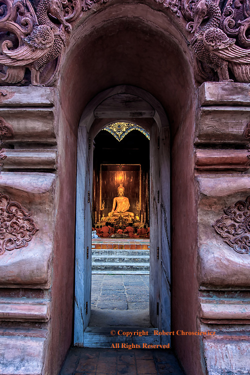 In Through the Out Door: A layered view leads one through the series of doors, stairs and passageways to the main temple at Wat Phantao, Chiang Mai Thailand.