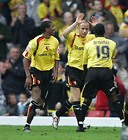 Photo: Lee Earle.<br /> Watford v Wolverhampton Wanderers. Coca Cola Championship. 29/10/2005. Anthony McNamee congratulates Watford's third goal scorer Paul Devlin.