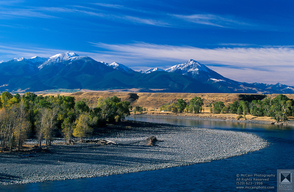 Yellowstone River and snow on Gallatin Mountain Range in area also known as Paradise Valley. Tallest point is Emigrant Peak at 10, 919 feet, Absaroka Beartooth Wilderness. Emigrant, Montana..September 20, 2000..Subject photograph(s) are copyright Edward McCain. All rights are reserved except those specifically granted by Edward McCain in writing prior to publication...McCain Photography.211 S 4th Avenue.Tucson, AZ 85701-2103.(520) 623-1998.mobile: (520) 990-0999.fax: (520) 623-1190.http://www.mccainphoto.com.edward@mccainphoto.com