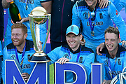 Eoin Morgan of England poses with the Cricket World Cup trophy during the presentation celebrations during the ICC Cricket World Cup 2019 Final match between New Zealand and England at Lord's Cricket Ground, St John's Wood, United Kingdom on 14 July 2019.