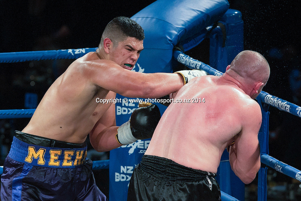 """Willis Meehan (L) lands a punch on Will `The Rock""""` Quarrie in the Mahindra Super 8 Fight Night, North Shore Events Centre, Auckland, New Zealand, Saturday, November 22, 2014. Photo: David Rowland/Photosport"""