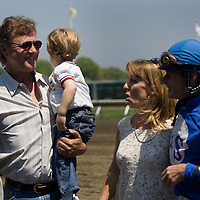 (PPAGE1) Monmouth Park 5/13/2006  Kevin G. Sleeter while holding son Justin 3 is all smiles after having trained the horse that won the opening day race at Monmouth Park.  Jockey Edwin L. King was the jocke who rode to victory.    Michael J. Treola Staff Photographer.....MJT