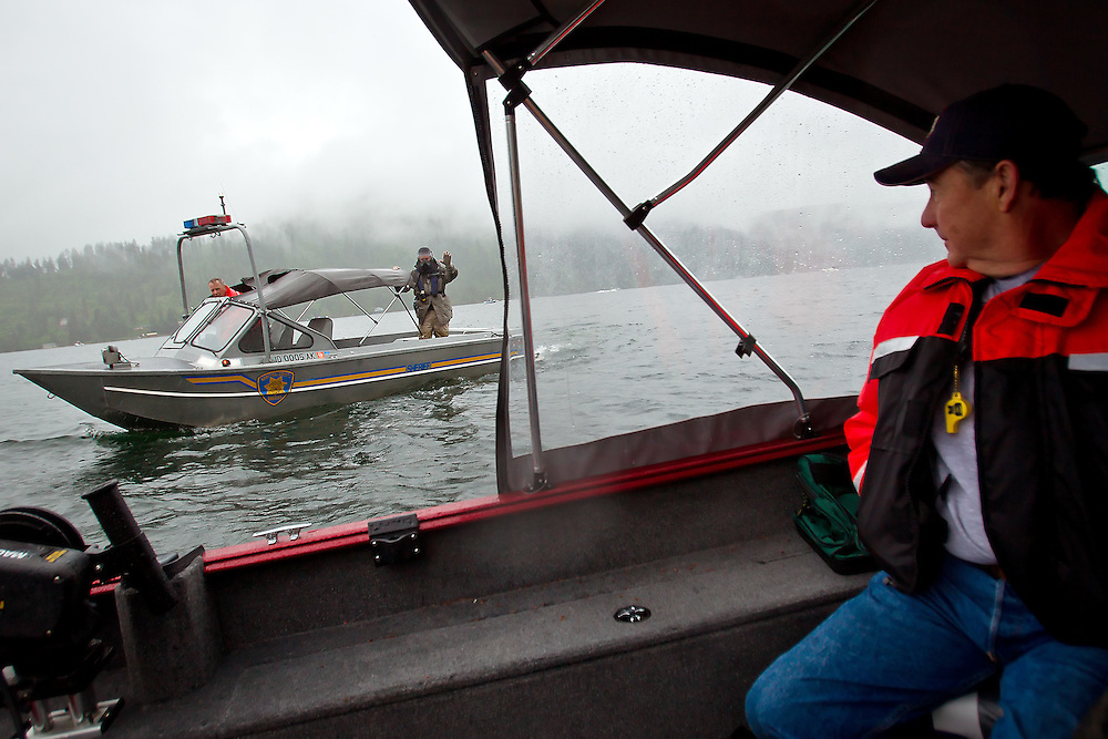 Mike Naumann, a training observer from the Boundary County Sheriff Department, watches as a Kootenai County Sheriff patrol boat approaches during the Marine Tactical Advantage Course held Friday near Higgens Point.