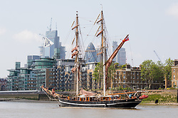 "© Licensed to London News Pictures. 23/05/2018. London, UK. The 107 year old tall ship, ""Eye of the Wind"" sails on the River Thames in front of City of London skyscrapers during a London visit to join celebrations to mark forty years since the start of Operation Drake - a two year round the world expedition, of which Eye Of The Wind was the flagship. One of the last traditional sailing ships left, Eye of the Wind was originally built in Germany in 1911 as a Schooner but was given a new lease of life in 1973 when she was bought by Anthony ""Tiger"" Timbs, an Englishman from greater London. A group of enthusiastic ship lovers began to rig the vessel as a brigantine and her full restoration at a shipard in Faversham, Kent took nearly four years to complete. Photo credit: Vickie Flores/LNP"