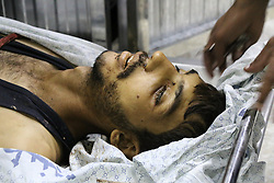 October 5, 2018 - The body of 24-year-old Mahmud Akram Abu Sama'an in the Shifa hospital in Gaza City after being shot dead by Israeli Security Forces during demonstrations on the east of Gaza City on 5rd October 2018. Thousands of Palestinians attended the Great March of Return rally at different sites along the Gaza-Israeli border this Friday and according to the Gaza Health Ministry three Palestinian protestors were killed today as a result of Israeli live fire, while over a hundred were injured by Israeli live ammunition and tear gas fired by the Israeli army at the protesters. Since March 30th, Palestinians have been holding weekly demonstrations calling for the lift of the 11-year-long Israeli blockade on the Palestinian enclave and the right of Palestinian refugees to return to their ancestral homes which were driven from or fled during the 1948 Arab-Israeli War. Mahmoud was a descent of 1948 Palestinian refugees and was living in the Al-Shati refugee camp located in the northern Gaza strip (Credit Image: © Ahmad Hasaballah/IMAGESLIVE via ZUMA Wire)