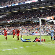 Bruno Zuculini, Manchester City, has his shot deflected onto the bar by Liverpool goalkeeper Simon Mignolet during the Manchester City Vs Liverpool FC Guinness International Champions Cup match at Yankee Stadium, The Bronx, New York, USA. 30th July 2014. Photo Tim Clayton