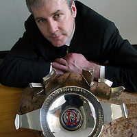 Derek Brown, Brands Heritage Director with Edrington Distillers with the Parliamentarian of the Year award which is to housed at the Famous Grouse Experience at Glenturret Distillery.<br />