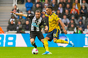 Paul Dummett (#3) of Newcastle United FC closes down Pierre-Emerick Aubameyang (#14) of Arsenal FC during the Premier League match between Newcastle United and Arsenal at St. James's Park, Newcastle, England on 11 August 2019.