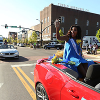 Annaka Shumpert, a Tupelo High School Sophomore Maid, waves to the crowd as she rides in the Tupelo Homecoming Parade Thursday afternoon in Tupelo.