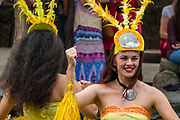 "A dance of Tahiti in the Canoe Pageant, ""Rainbows of Paradise."" The Polynesian Cultural Center (PCC) is a major theme park and living museum, in Laie on the northeast coast (Windward Side) of the island of Oahu, Hawaii, USA. The PCC first opened in 1963 as a way for students at the adjacent Church College of Hawaii (now Brigham Young University Hawaii) to earn money for their education and as a means to preserve and portray the cultures of the people of Polynesia. Performers demonstrate Polynesian arts and crafts within simulated tropical villages, covering Hawaii, Aotearoa (New Zealand), Fiji, Samoa, Tahiti, Tonga and the Marquesas Islands. The PCC is run by the Church of Jesus Christ of Latter-day Saints (LDS Church). For this photo's licensing options, please inquire."
