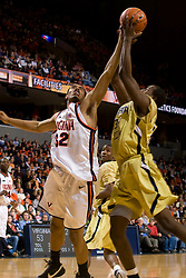 Virginia forward Mike Scott (32) battles Georgia Tech forward Zach Peacock (35) for a loose ball.  The Virginia Cavaliers men's basketball team fell to the Georgia Tech Yellow Jackets 92-82 in overtime at the John Paul Jones Arena in Charlottesville, VA on January 27, 2008.