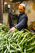 FEZ, MOROCCO - 05th MARCH 2016 - Market trader sells fresh fruit and vegetables at a market stall in the old Fez Medina, Middle Atlas Mountains, Morocco.
