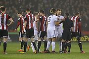 Players gather as Middlesbrough midfielder Grant Leadbitter is shown a red card during the EFL Sky Bet Championship match between Sheffield United and Middlesbrough at Bramall Lane, Sheffield, England on 10 April 2018. Picture by Aaron  Lupton.