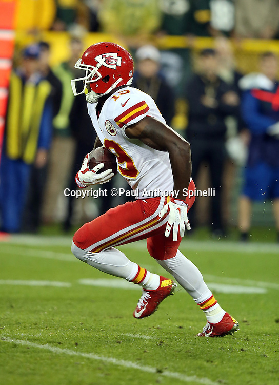 Kansas City Chiefs wide receiver Jeremy Maclin (19) catches and runs with a 31 yard pass reception for a first down and goal to go at the 7 yard line in the third quarter during the 2015 NFL week 3 regular season football game against the Green Bay Packers on Monday, Sept. 28, 2015 in Green Bay, Wis. The Packers won the game 38-28. (©Paul Anthony Spinelli)