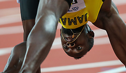 London, 2017-August-04. Usain Bolt settles in to his blocks at  the start of his Men's 100m heat at the IAAF World Championships London 2017. Paul Davey.