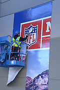 January 22, 2015; Phoenix, AZ, USA; Mike Tovar applies graphics to the walls of the Phoenix Convention Center in advance of Super Bowl XLIX between the Seattle Seahawks and the New England Patriots.