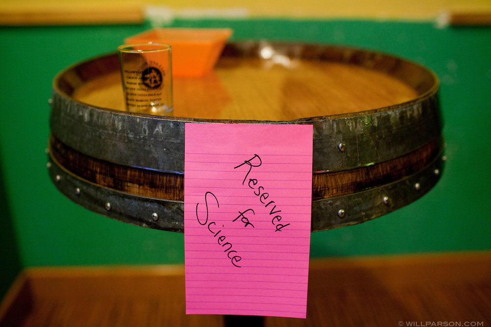 A sign in the front room at Ballast Point Brewing Company's headquarters in Escondido marks a table as reserved for a science tour.
