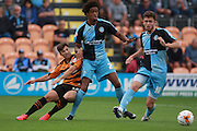 Barnet player Luke Gambin is shrugged off the ball by Wycombe Wanderers players Sido Jombati and Dan Rowe during the Sky Bet League 2 match between Barnet and Wycombe Wanderers at The Hive Stadium, London, England on 15 August 2015. Photo by Bennett Dean.