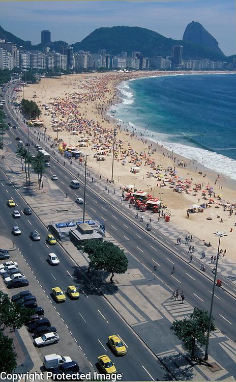 Copacabana Beach and Avenida Atlantica, with Sugar Loaf in background, Rio de Janeiro, Brazil