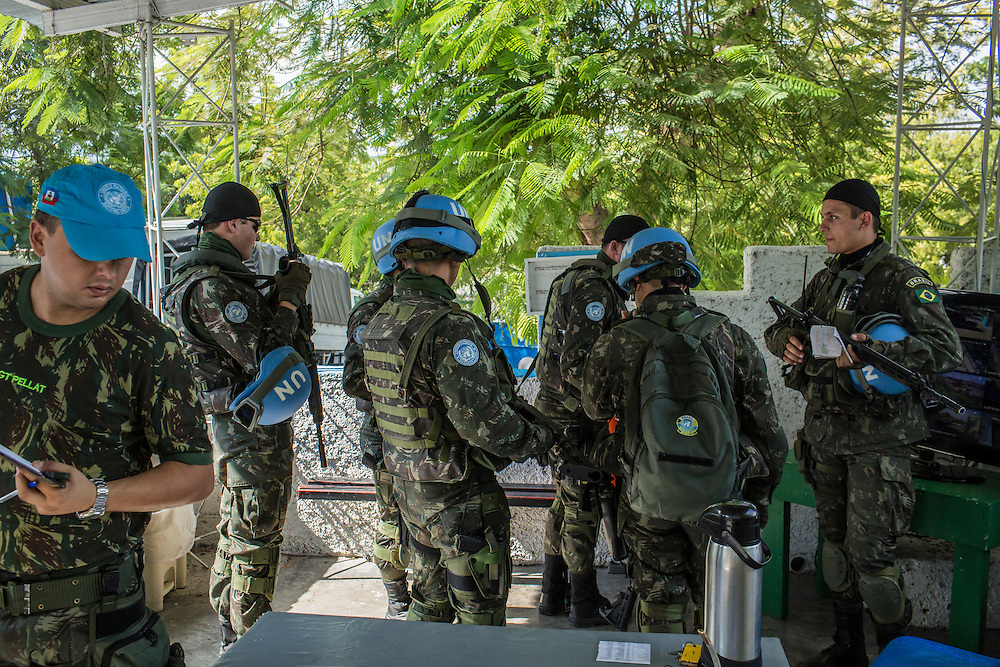 UN peacekeeping troops, operating under the auspices of MINUSTAH, get organized at their base in Fort National before heading out to police a planned anti-government protest downtown on Tuesday, December 16, 2014 in Port-au-Prince, Haiti. The UN has a controversial record in Haiti, and is extremely unpopular.