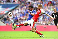 Diego Costa of Chelsea challenges for the ball with Per Mertesacker of Arsenal - Mandatory by-line: Dougie Allward/JMP - 27/05/2017 - FOOTBALL - Wembley Stadium - London, England - Arsenal v Chelsea - Emirates FA Cup Final