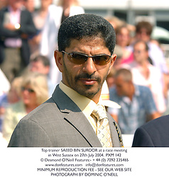 Top trainer SAEED BIN SUROOR at a race meeting in West Sussex on 27th July 2004.PXM 142
