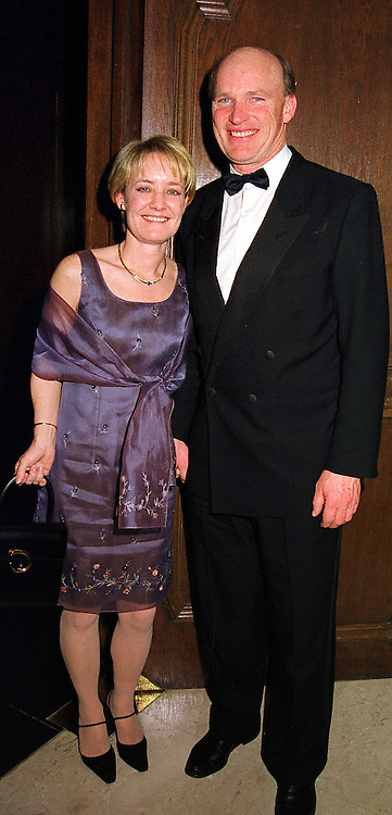 MR & MRS JOHN GOSDEN he is the racehorse trainer at a dinner in London on 17th November 1999.MZE 56