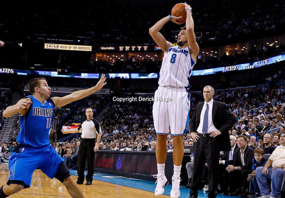 November 17, 2010; New Orleans, LA, USA; New Orleans Hornets shooting guard Marco Belinelli (8) of Italy shoots over Dallas Mavericks point guard Jose Juan Barea (11) during the second half at the New Orleans Arena. The Hornets defeated the Mavericks 99-97. Mandatory Credit: Derick E. Hingle
