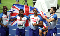 Great Britain's Men's 4x400m relay team (left to right) Dwayne Cowan, Rabah Yousif, Matthew Hudson-Smith and Martyn Rooney celebrate winning silver in the Final during day five of the 2018 European Athletics Championships at the Olympic Stadium, Berlin. PRESS ASSOCIATION Photo. Picture date: Saturday August 11, 2018. See PA story ATHLETICS European. Photo credit should read: Martin Rickett/PA Wire. RESTRICTIONS: Editorial use only, no commercial use without prior permission
