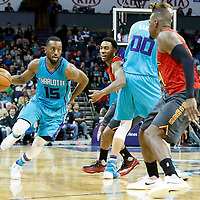 01 November 2015: Charlotte Hornets guard Kemba Walker (15) drives past Atlanta Hawks guard Jeff Teague (0) on a screen set by Charlotte Hornets forward Spencer Hawes (00) during the Atlanta Hawks 94-92 victory over the Charlotte Hornets, at the Time Warner Cable Arena, in Charlotte, North Carolina, USA.