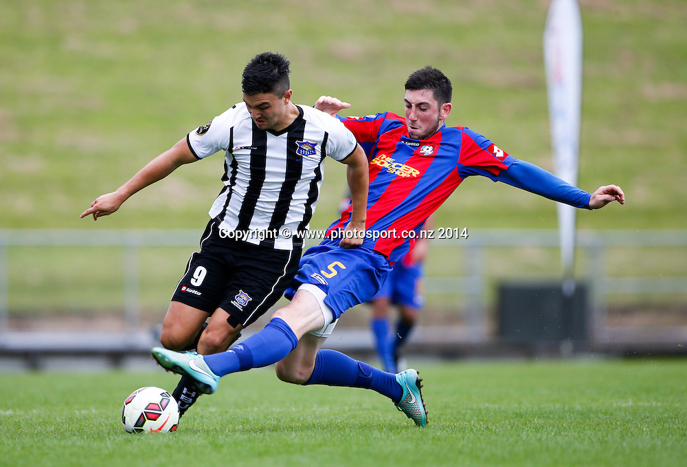 HB United's Sean Lovemore is brought down by Sam O'Regan. ASB Premiership Footbal Match. WaiBoP United v Hawkes Bay United, Rotorua International Stadium, Rotorua, New Zealand. Saturday, 20 December, 2014. Photo: John Cowpland / photosport.co.nz
