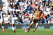 Hull City midfielder Kamil Grosicki (14) battles for possession  with West Bromwich Albion defender (on loan from Manchester City) Oluwatosin Adarabioyo during the EFL Sky Bet Championship match between West Bromwich Albion and Hull City at The Hawthorns, West Bromwich, England on 19 April 2019.