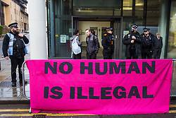 Chelmsford, UK. 6th February, 2019. A banner draped over a barrier outside Chelmsford Crown Court during a protest arranged to coincide with the sentencing of the Stansted 15. The Stansted 15 were convicted on 10th December of an anti-terrorism offence under the Aviation and Maritime Security Act 1990 following non-violent direct action to try to prevent a Home Office deportation flight carrying precarious migrants to Nigeria, Ghana and Sierra Leone from taking off from Stansted airport in March 2017.