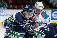 KELOWNA, CANADA - APRIL 5: Roberts Lipsbergs #29 of the Seattle Thunderbirds faces off against Colton Heffley #25 of the Kelowna Rockets on April 5, 2014 during Game 2 of the second round of WHL Playoffs at Prospera Place in Kelowna, British Columbia, Canada.   (Photo by Marissa Baecker/Getty Images)  *** Local Caption *** Roberts Lipsbergs; Colton Heffley;