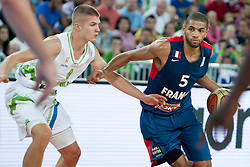 Edo Muric of Slovenia and Nicolas Batum of France during last friendly match before Eurobasket 2013 between National teams of Slovenia and France on August 31, 2013 in SRC Stozice, Ljubljana, Slovenia. (Photo by Urban Urbanc / Sportida.com)