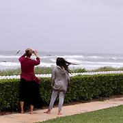 Locals gather in Palm Beach Wednesday October 6, 2016, waiting for the arrival of Hurricane Matthew. Warnings are in place along much of Florida's Atlantic coastline, for Category 3 Hurricane Matthew.<br />