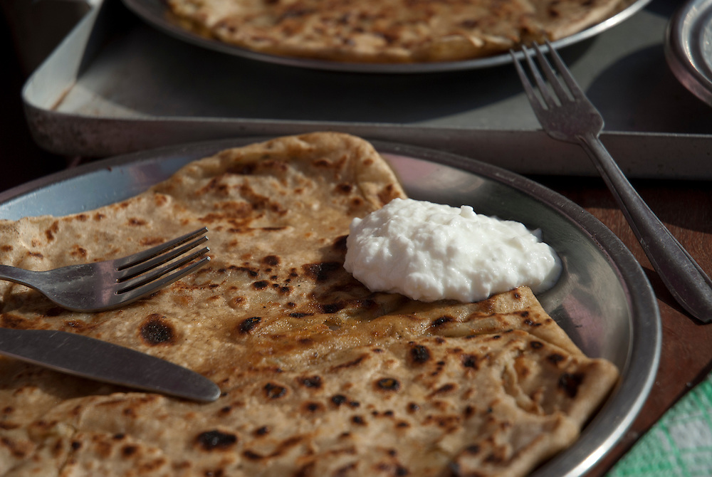 A paratha (parantha, parauntha)  is an Indian flat-bread that originated in the Indian subcontinent. Paratha is an amalgamation of the words parat  and atta which literally means layers of cooked dough. Often served with curd and pickles, a nice breakfast!