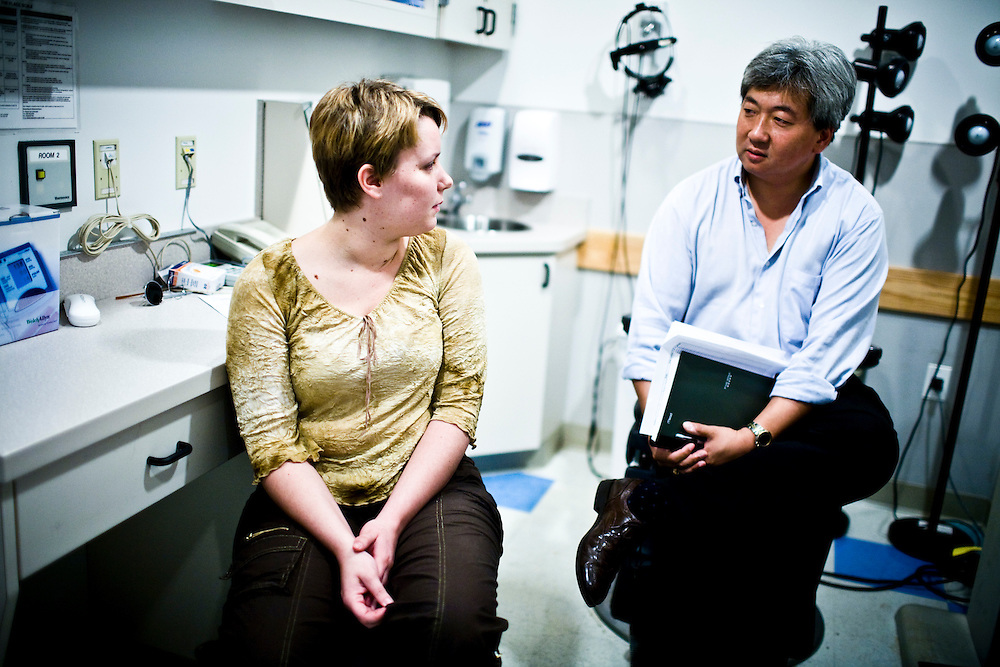 Alisha Bacoccini speaks with a doctor after being tested on her ability to detect color, at UPenn Hospital, in Philadelphia, PA on Monday, June 23, 2008. Bacoccini is undergoing an experimental gene therapy trial to improve her sight.