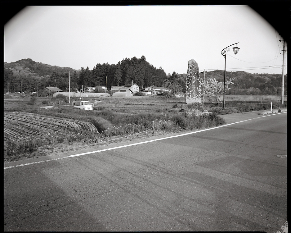Katsuzo Shoji's (75) family has worked   this land for  more then 6 generations Like the rest of the town's population  he is being forced to evacuate most likely to an apartment 20km away.  uncertain when he will be able to return he has been able to rent some land to continue his work  outside of the  heavily  contaminated village.  the  Fukushima Daiichi nuclear power plant, about 40km away.  Outside the 20km government exclusion zone, the village's mountainous topography  funneled radiation spewing from its crippled reactors trapping it there, poisoning crops , water and livestock.  he has  been told  he must  destroy his crops and  his six prized  Iitate beef cows must be killed.